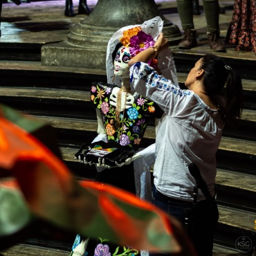 A Catrina doll being decorated