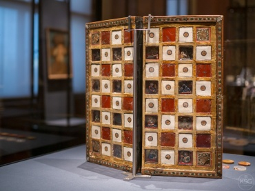 Game board for chess and backgammon, probably from Venice, 1st half of the 14th century with later alterations. It has enclosed miniatures under rock crystal.