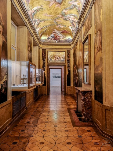The Golden Cabinet has beautiful wall and ceiling paintings, as well as a display of globe-related instruments.