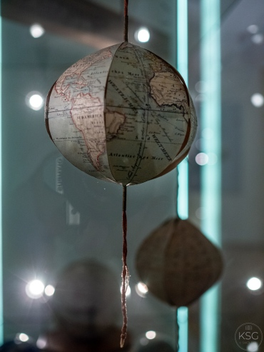 small paper globes